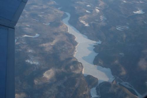 Do you see hills and a frozen lake and river?
