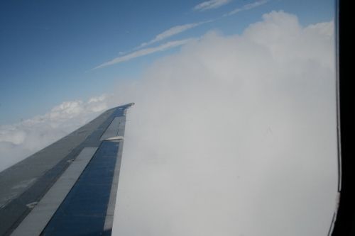 Their are many beautiful clouds outside the airplane window! They see lots of stratus, cumulous and wispy, cirrus clouds!