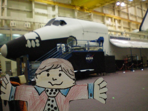 Flat Stanley in front of the Space Shuttle model.