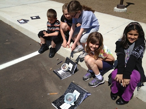 Solar Power! Third grade scientists engineer some solar cookers made from recycled materials!